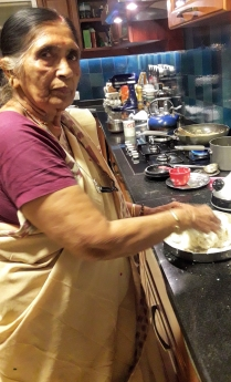 My mom making akki roti